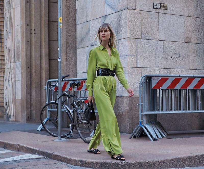MILAN, ITALY -JUNE 15, 2018: Linda tol posing for photographers in the street after ALBERTA FERRETTI fashion show. Linda Tol walking for photographers in the stock photography