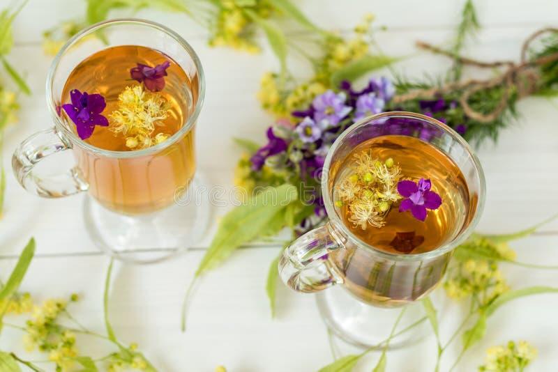 Linden herbal tea in transparent grog glass stock image