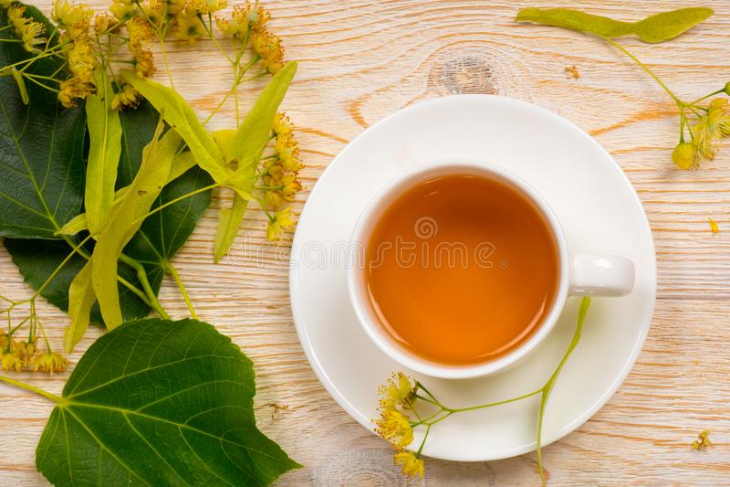 Linden herbal tea on wooden table royalty free stock image