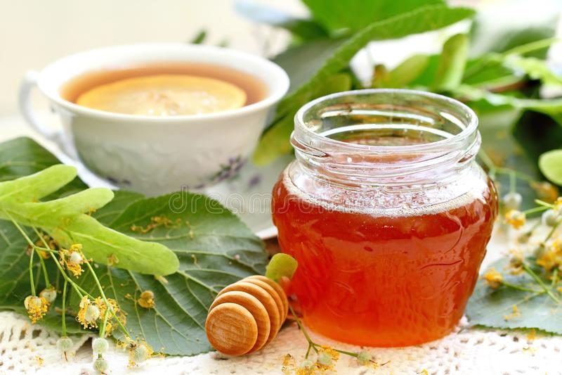Linden honey in glass jar stock photography