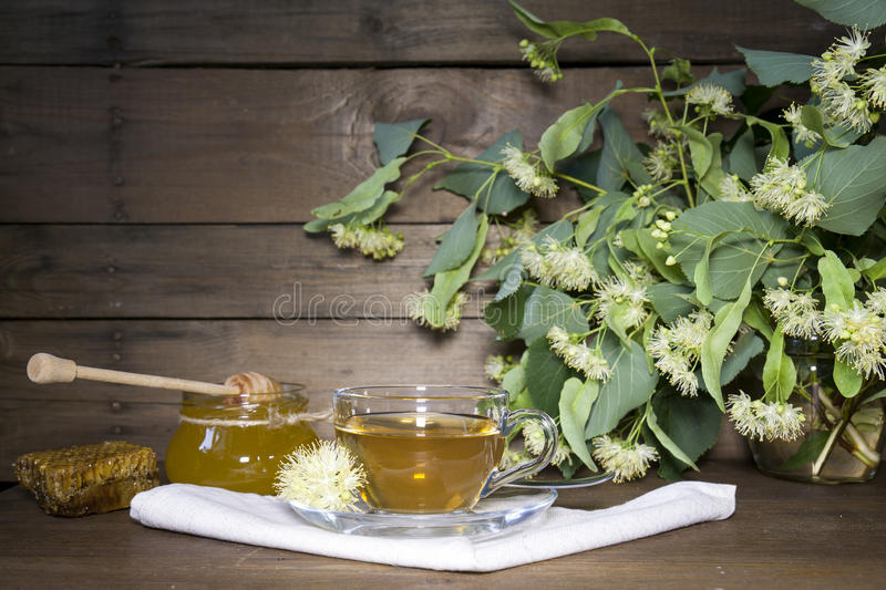 Linden tea in glass cup and jar with honey royalty free stock photography