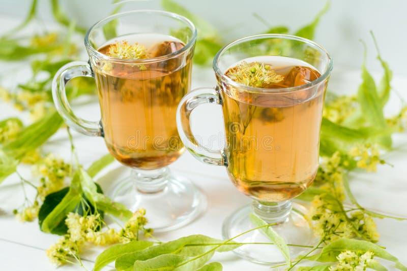 Linden tea in transparent grog glass royalty free stock photo