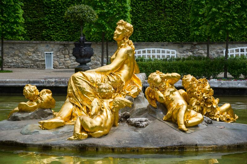 Linderhof Palace. Fountain group Flora and puttos. Bavaria, Germany. Ettal, Germany - June 5, 2016: Famous Linderhof Palace. Amazing fountain group Flora and royalty free stock image