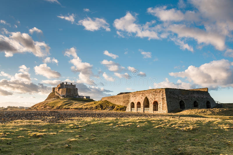 Lindisfarne Castle and Lime Kiln. The Lime Kiln on Holy Island next to Lindisfarne Castle have a long history, originally worked by the monks stock photo