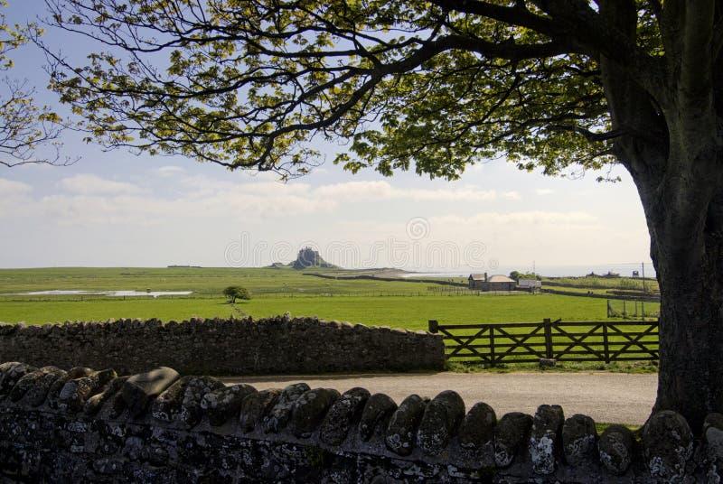 Lindisfarne slott på den heliga ön, Northumberland, England. royaltyfria bilder