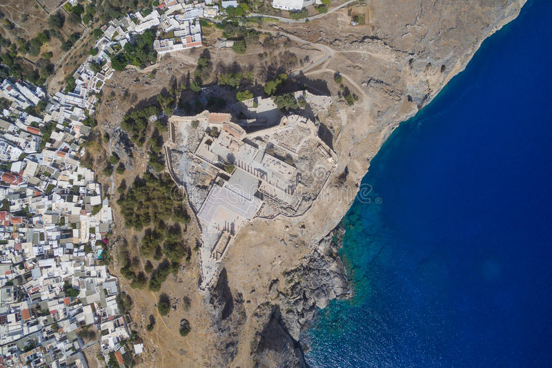 Lindos Acropolis - Aerial image. Of the Acropolis, white houses and blue bay of Lindos, Rodos Greece stock images