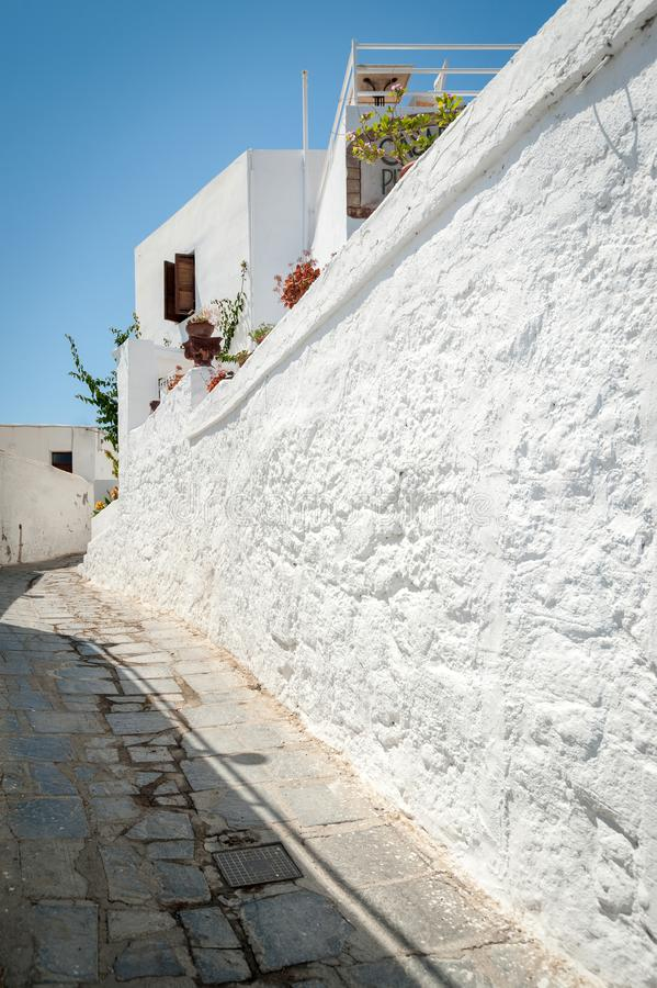 Street view at narrow alley with residential whitewash households. Island of Rhodes. Europe stock image