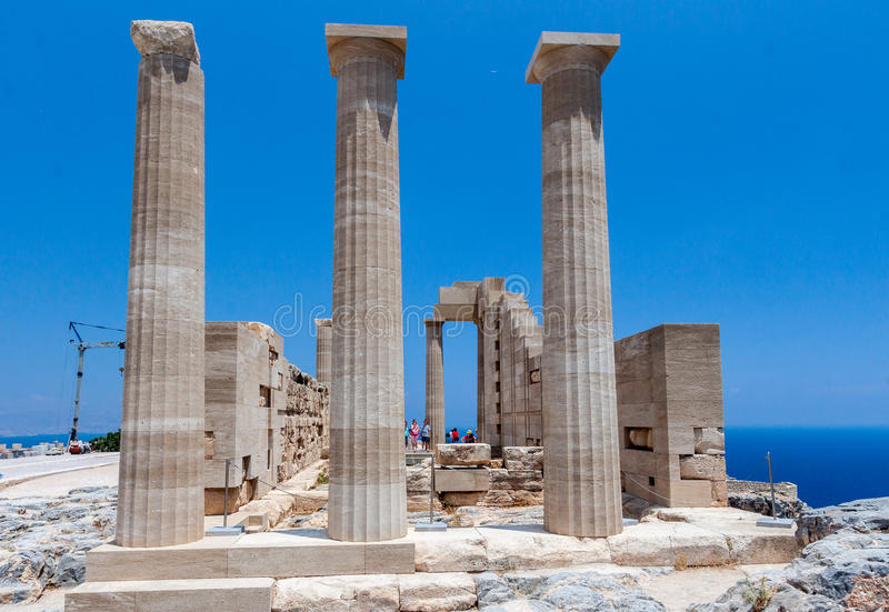Lindos Rhodes Greece. The blue waters and the ruins of the ancient greek Athena temple. Lindos, Rhodes Island, Greece stock photos