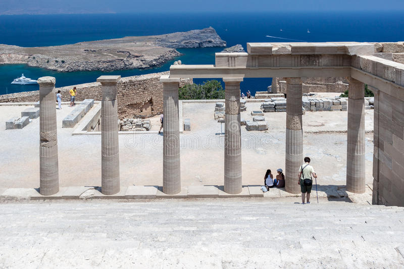 Lindos Rhodes Greece. The blue waters and the ruins of the ancient greek Athena temple. Lindos, Rhodes Island, Greece royalty free stock images