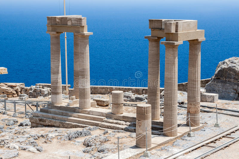 Lindos Rhodes Greece. The blue waters and the ruins of the ancient greek Athena temple. Lindos, Rhodes Island, Greece royalty free stock photography