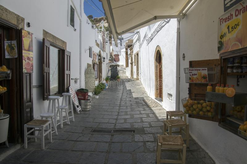 Lindos, Rhodes / GREECE - September 7, 2017: village streets without tourists, beautiful white houses, shops and narrow streets royalty free stock images