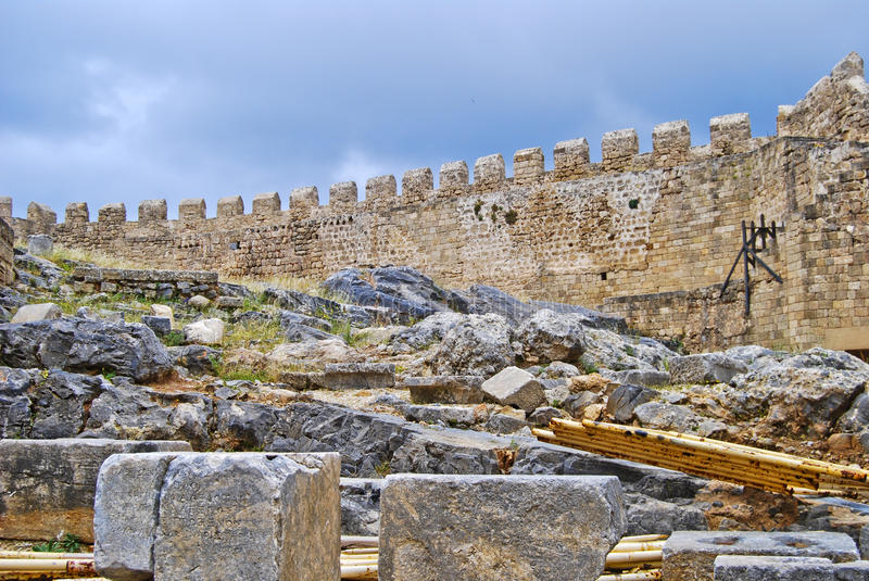 Lindos (ruins of the castle). Lindos is a town and an archaeological excavation site located on the east coast of the greek island of rhodes, the city is also royalty free stock photo