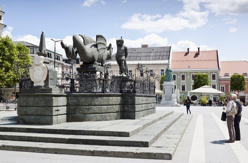 Lindwurm fountain at Neuer Platz in Klagenfurt. The Lindwurm (built around 1590), Klagenfurt's heraldic animal, originally a bipedal dragon, which glides royalty free stock image