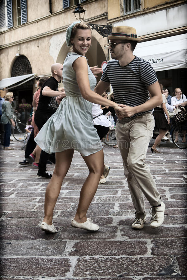 Lindy Hop Flash Mob. Flash Mob itinerant in the city center of Parma, Italy. The Swing is coming back with all his energy and all his load of happiness