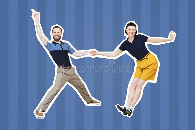 Lindy hop or rock`n`roll dance boogie woogie dancers. Lindy hop or rock`n`roll dance boogie woogie. Boogie acrobatic stunt in a studio background. Dance for rock royalty free stock images