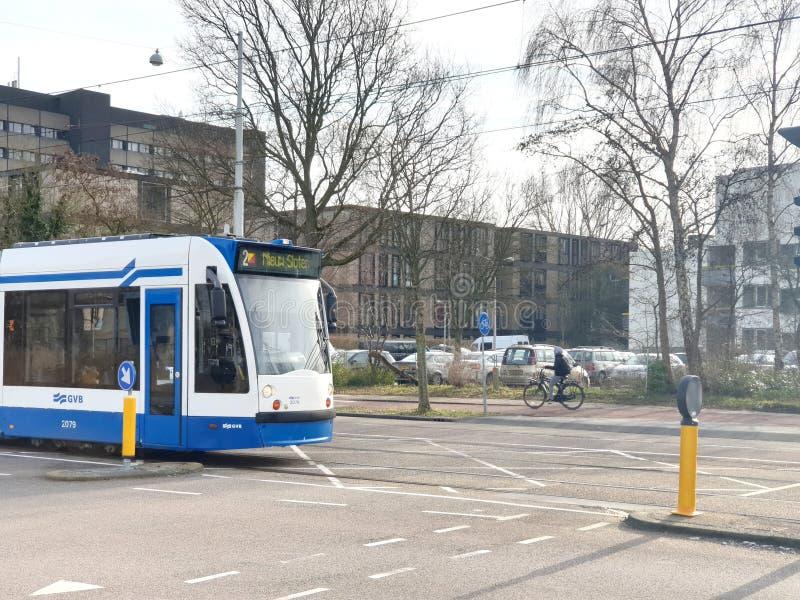 Line 2 of the Amsterdam street car network type Siemens combino tram on the Louwensweg heading Sloten royalty free stock image
