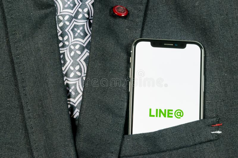 Line application icon on Apple iPhone X screen close-up in jacket pocket. Line app icon. Line is an online social media network. S. Sankt-Petersburg, Russia royalty free stock photography