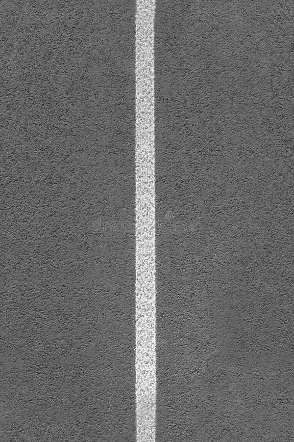 Line on asphalt (tiled, seamless texture) stock photo