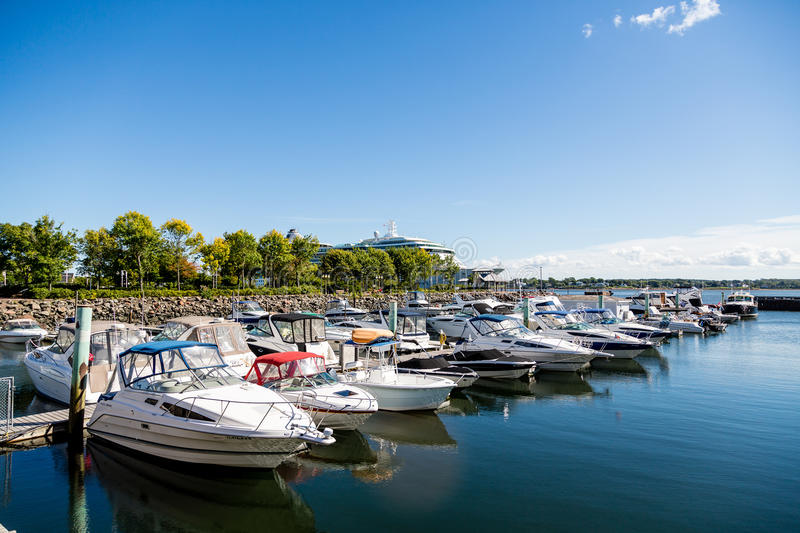 Line of Boats in Blue Harbor. Fishing boats in harbor of Charlottetown, Prince Edward Island royalty free stock photography