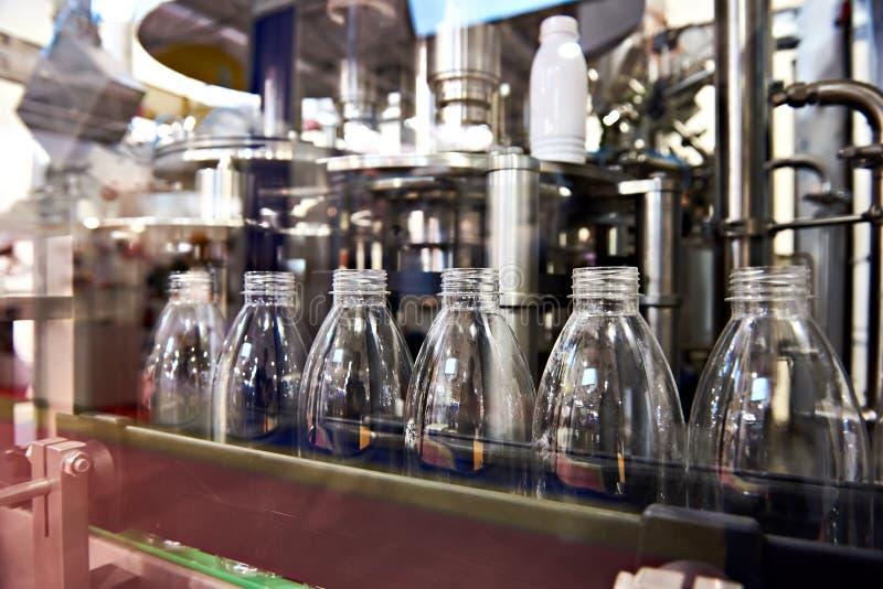 Line of bottling beverages in plastic bottles. On factory stock photography
