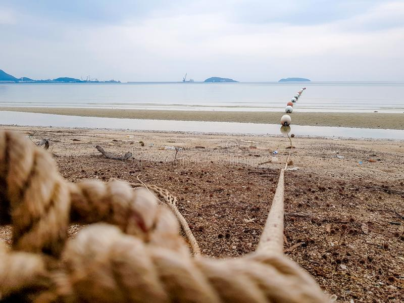 Line of buoys in the sea shore. Line of buoys attached to big rope to show boundary in the sea shore royalty free stock images