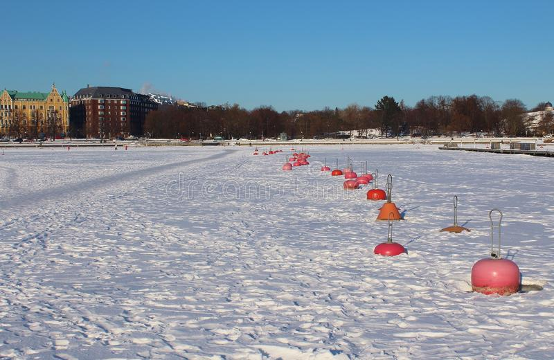 Line of Buoys in the Frozen Baltic Sea, Helsinki, Finland. stock images