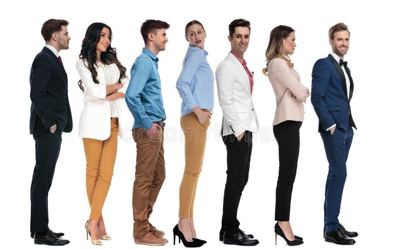 Line of casual and elegant young people stock photography