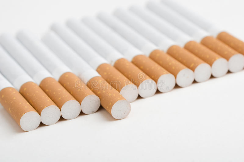 Download A Line Of Cigarettes On White Stock Image - Image: 11408265