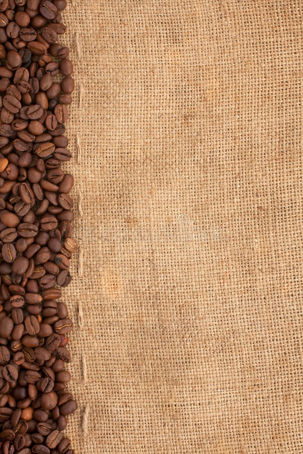 Line Of Coffee Beans And Burlap Royalty Free Stock Photography