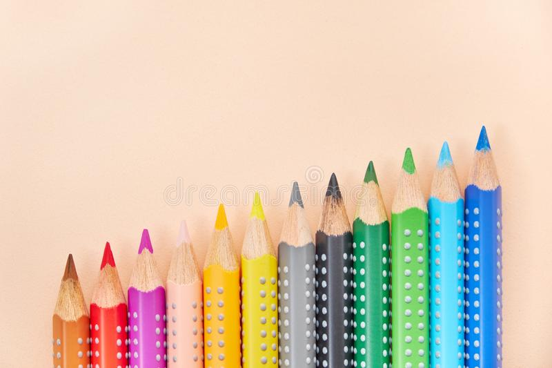Line of colored pencils, background with copy space stock image