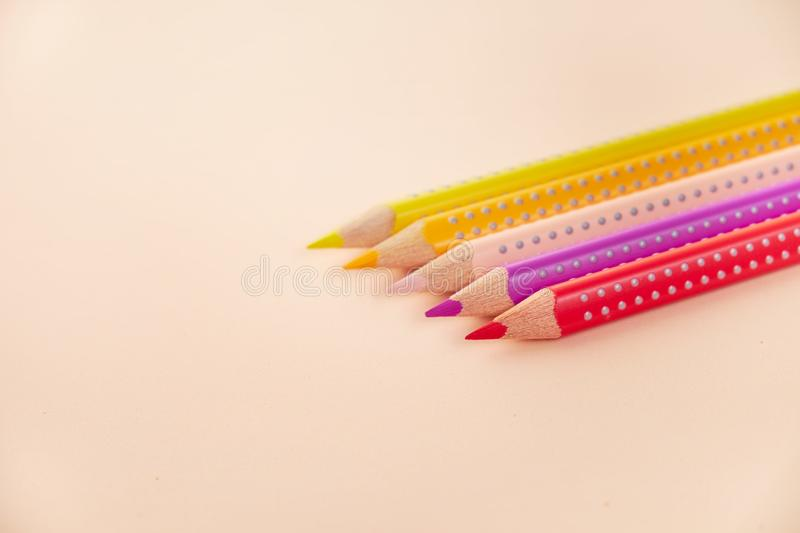 Line of colored pencils on background royalty free stock photo