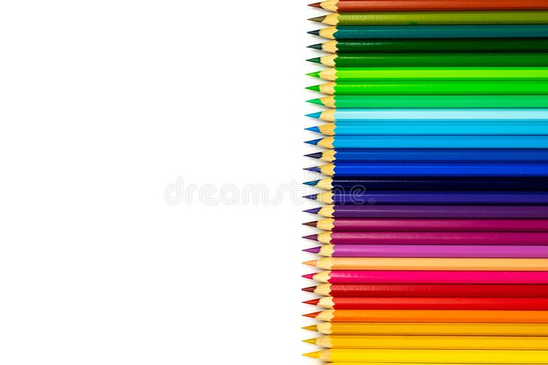 Line of colored pencils. Education frame concept. Close up royalty free stock image