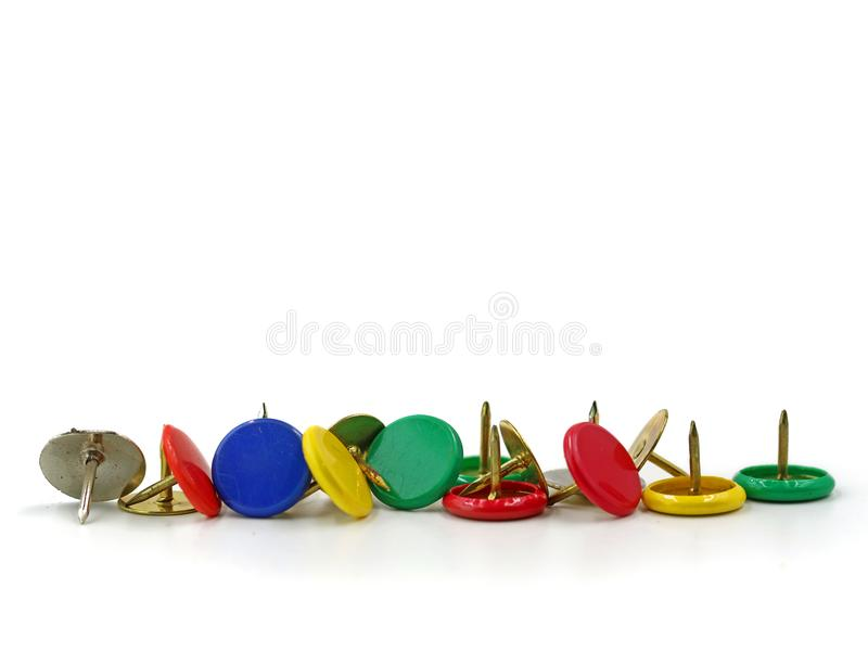 Line of colorful push pins isolated on white background, front view copy space royalty free stock photography