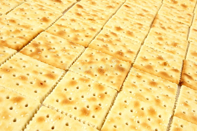 Line of crackers. Diagonal lines of salted crackers stock photos