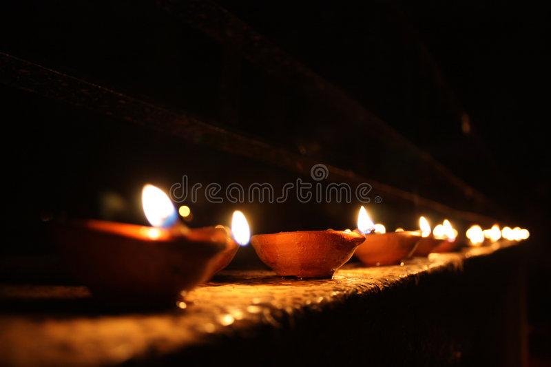 Line of Diwali Lamps. A background with a beautiful line of traditional lamps lit on the occasion of Diwali festival in India