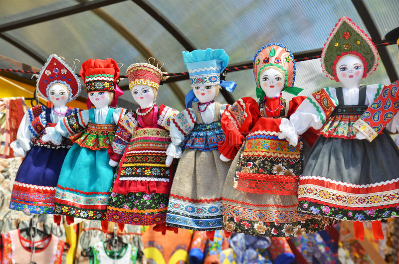 Line of dolls in russian national costume. At the souvenir market royalty free stock photography