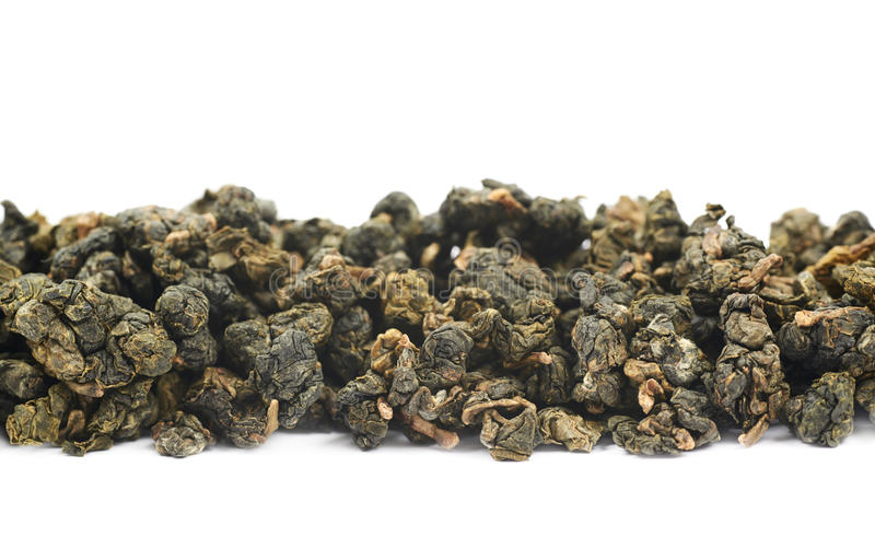 Line of dried green tea isolated stock image