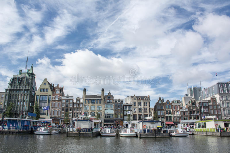 Line of dutch houses in Amsterdam near the canal royalty free stock image