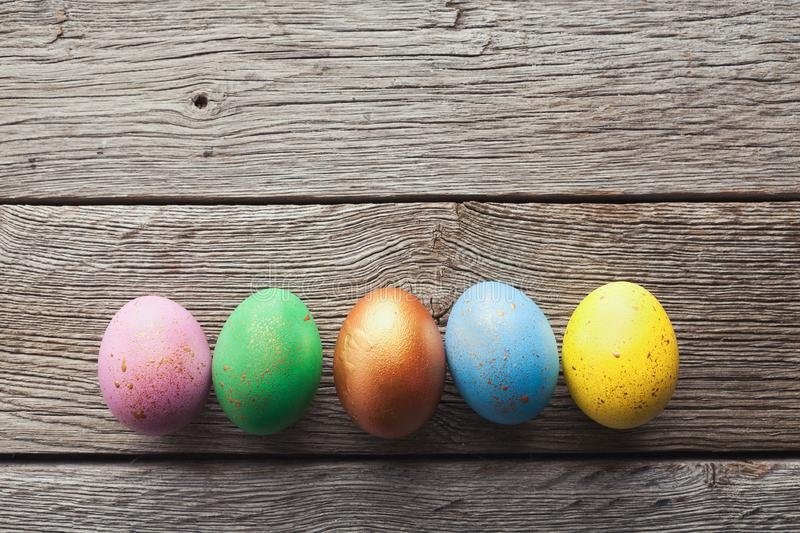Line of easter eggs on wooden background. stock photos