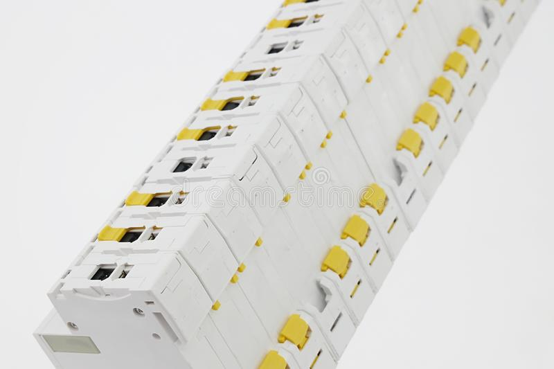 Line of electrical installation modules such as circuit breakers, fuses etc. viewed from back side royalty free stock photography