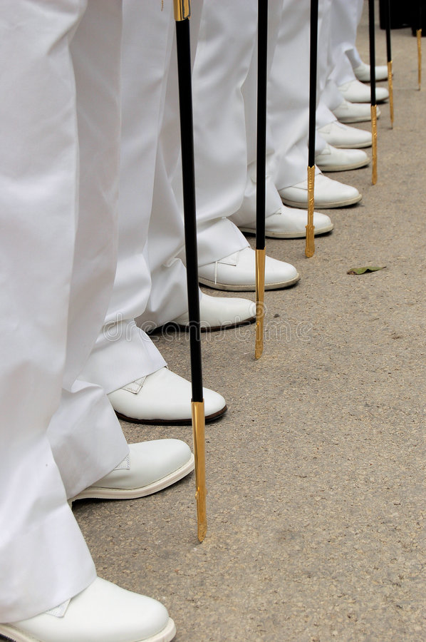 Line of feets and swords stock photo