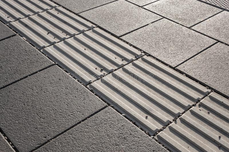 Line of tactile paving along the edge of platform at the train station royalty free stock images