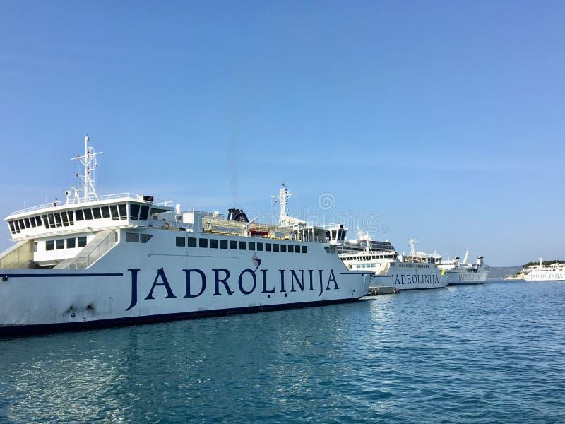 A line of Jadrolinija ferries docked up in the port of Split, Croatia. Split, Croatia - July 7th, 2019: A line of Jadrolinija ferries docked up in the port of stock images