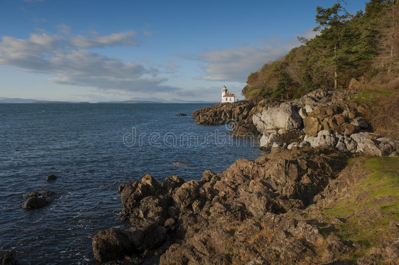 Line Kiln Lighthouse. Located on San Juan Island, in Washington state, It guides ships through the Haro Straits and is part of Lime Kiln Point State Park. It stock photo