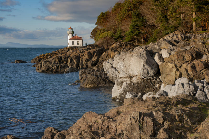 Line Kiln Lighthouse. Located on San Juan Island, in Washington state, It guides ships through the Haro Straits and is part of Lime Kiln Point State Park. It royalty free stock images
