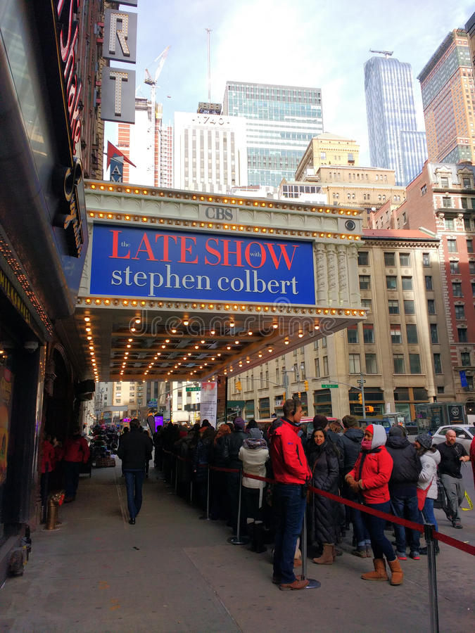 Line for The Late Show With Stephen Colbert, Ed Sullivan Theater, CBS Studio 50, NYC, USA. Greeters welcome those arriving to attend The Late Show With Stephen royalty free stock photos