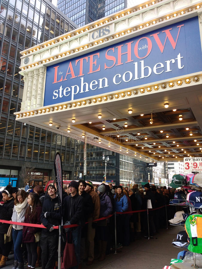 Line for The Late Show With Stephen Colbert, Ed Sullivan Theater, CBS Studio 50, NYC, USA. People wait in line to attend The Late Show With Stephen Colbert at stock photography