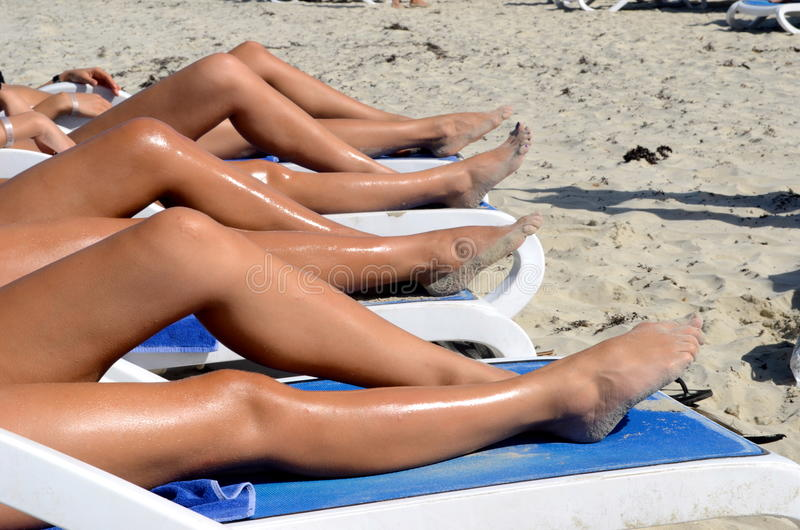 Download Line Of Legs On The Chaise Lounges Stock Photo - Image of awesome, view: 22297238