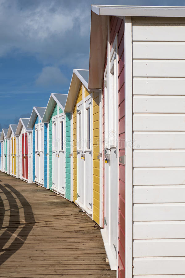 Line of locked English seaside chalets out of season royalty free stock image