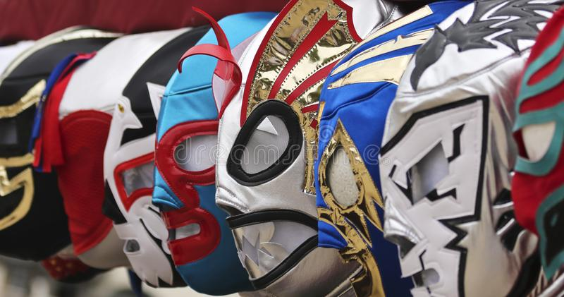 A Line of Lucha Libre Luchador Masks. A Colorful Assortment of Lucha Libre Luchador Masks royalty free stock photo